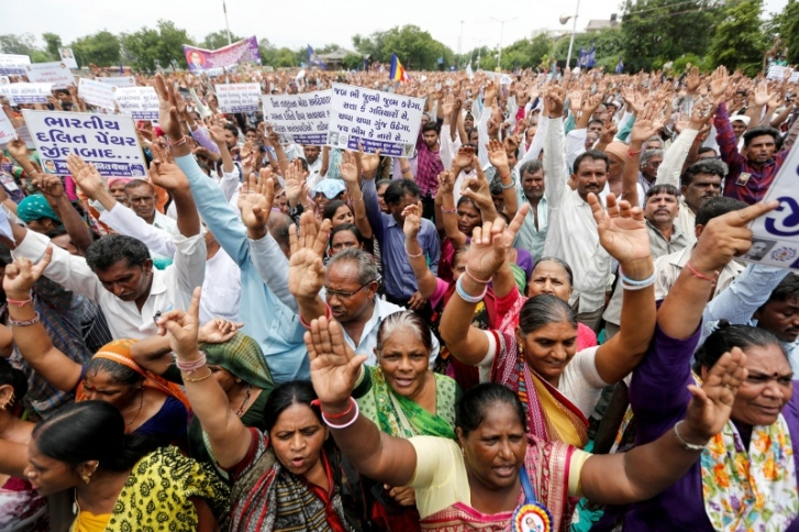 People shout slogans as they attend a protest rally against what they say are attacks on India's low-caste Dalit community in Ahmedabad